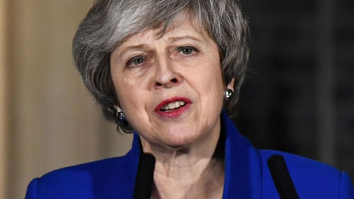 Theresa May insists Brexit deadline still stands after reports of a possible 'long' delay