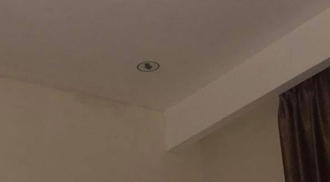 Hotel guests 'baffled and stressed' over bizarre sign on ceiling