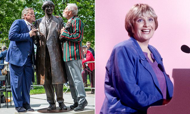 Bronze statue of Victoria Wood is unveiled outside hometown library