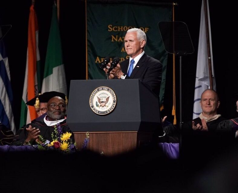 Dozens of graduates walk out before Mike Pence commencement address at Indiana university