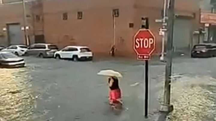 Video shows woman cross flooded Brooklyn street during hellish storm