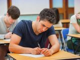 Teenagers braced for GCSE misery after exam bosses made tests tougher