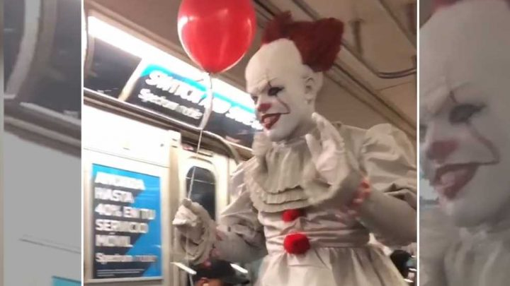 Creep dressed as Stephen King's Pennywise strolls through subway