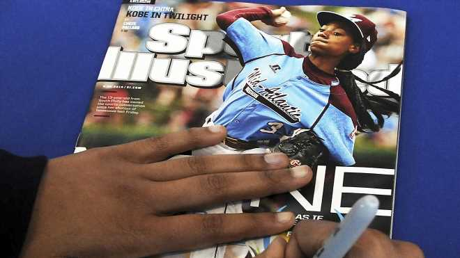 Sports Illustrated's new management slashes staff jobs