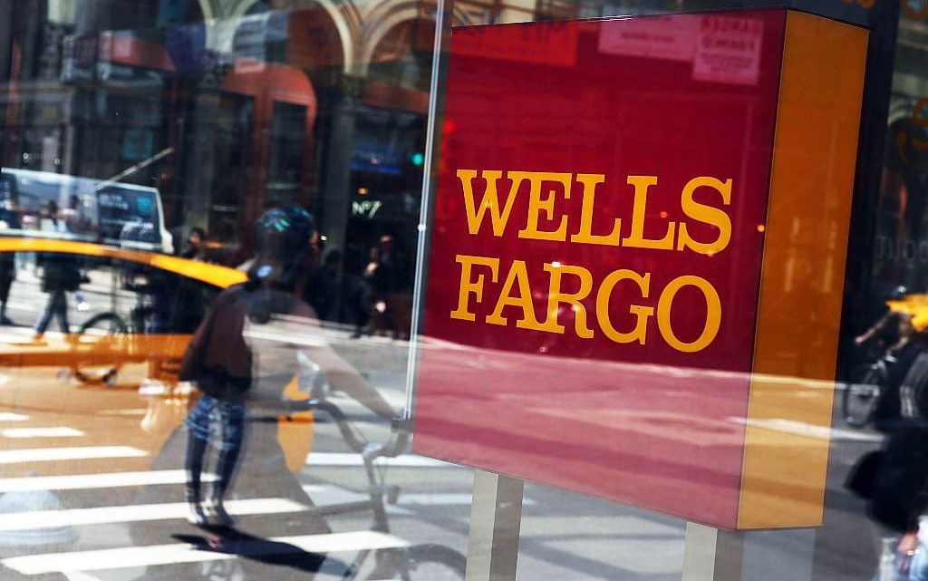 Wells Fargo fourth-quarter profit drops 50% as legal fees, low interest rates weigh on results