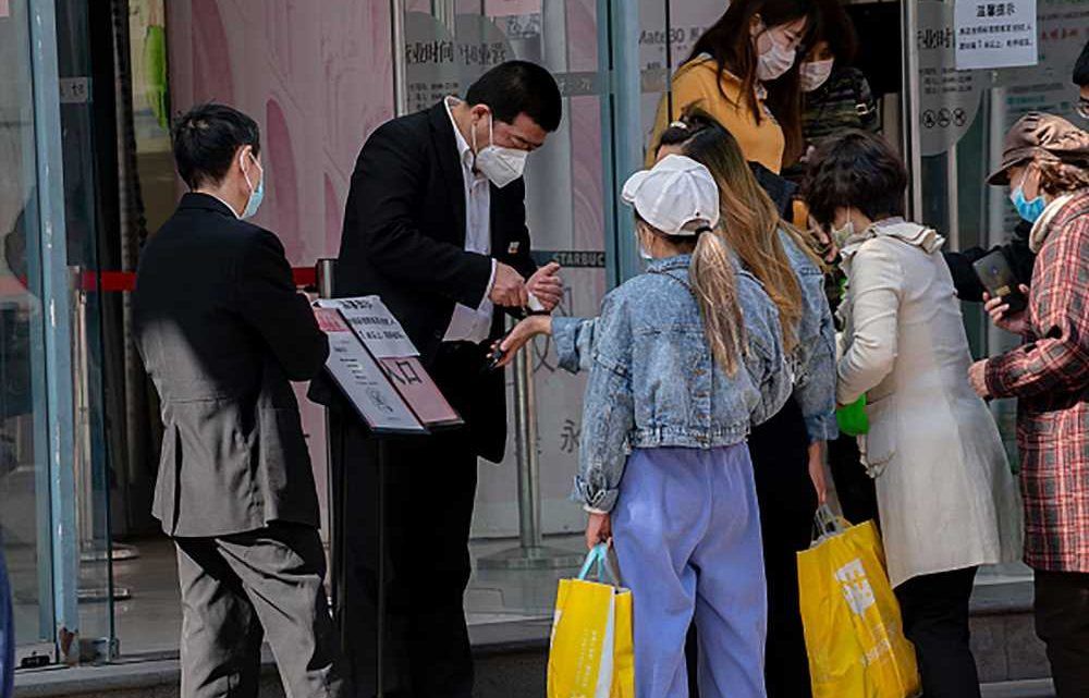 China's retailers offer deals to kick-start spending amid coronavirus decline