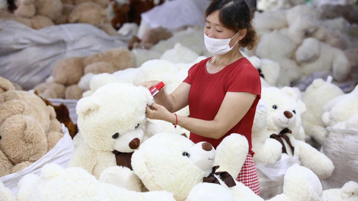 China's July retail sales unexpectedly slip, factory output growth steady