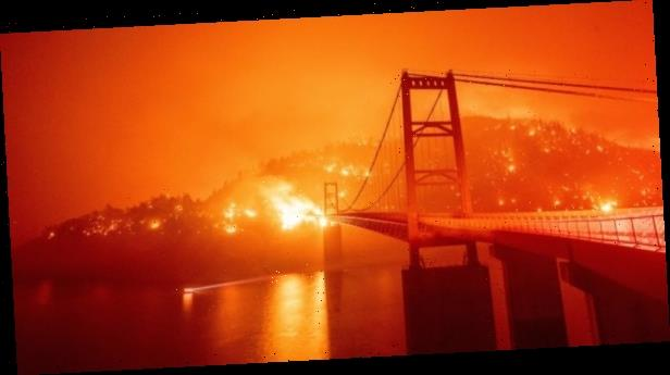 Explosive wildfires across California stoked by fierce winds