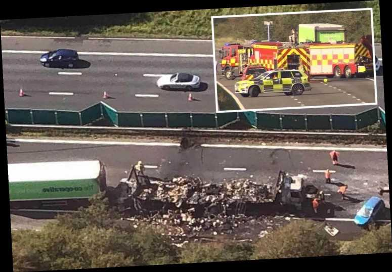 Lorry driver, 37, killed after crashing into truck that was trying to protect smashed Fiesta on M5 as man, 21, arrested