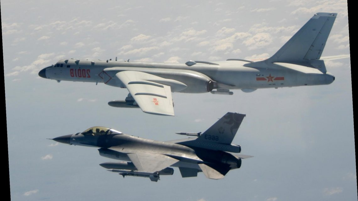 China Taiwan tensions bubble as Beijing holds massive war games on island's doorstep and jets invade airspace 17 times