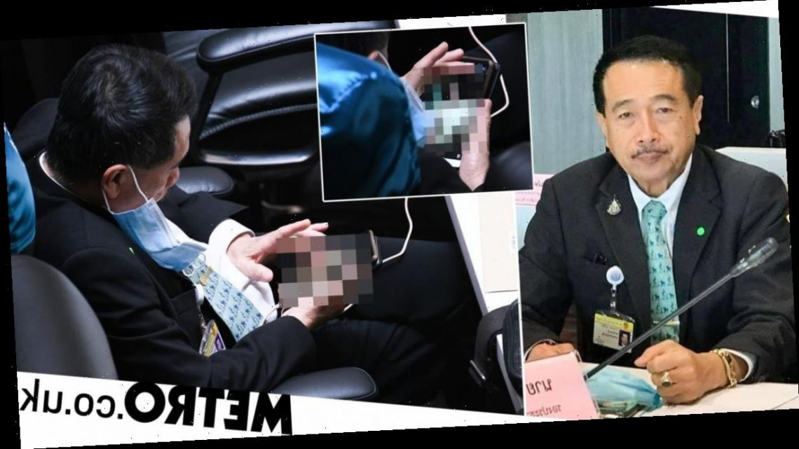 MP caught looking at porn on his phone in Thai parliament