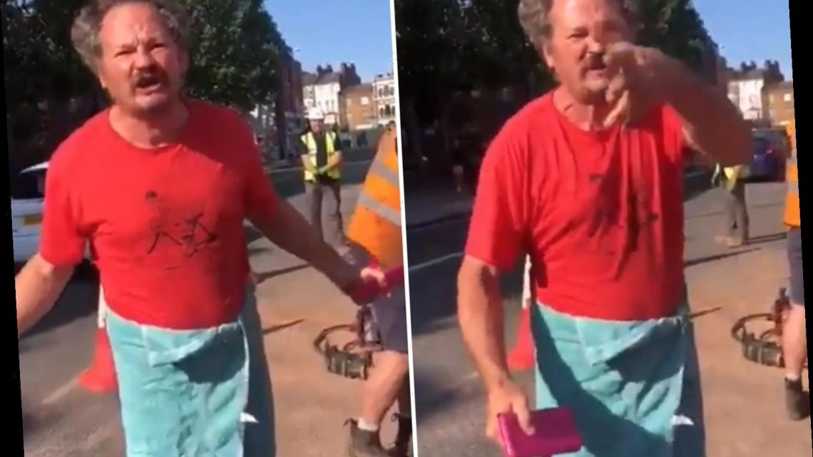 Shocking moment man in a towel tells 'white South African' to 'f**k off' in racist rant