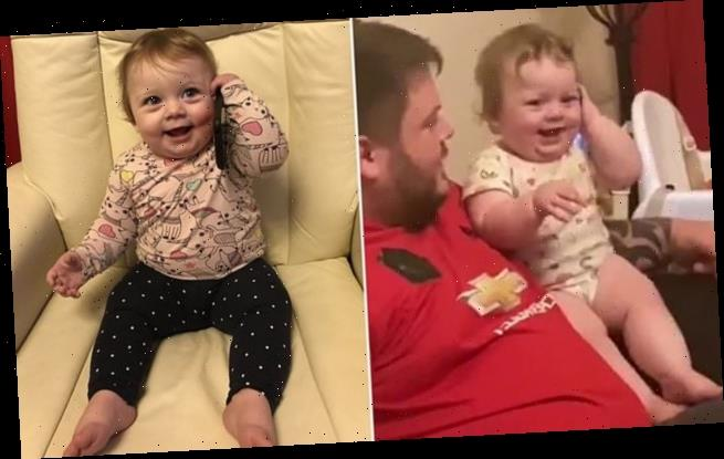 Baby's hilarious reaction when phone she's playing with suddenly rings