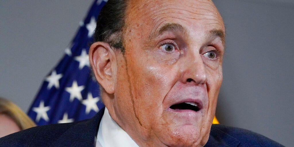 Rudy Giuliani's hair dye trickled down his face at a wild news conference where he quoted 'My Cousin Vinny' to support his legal arguments about the election