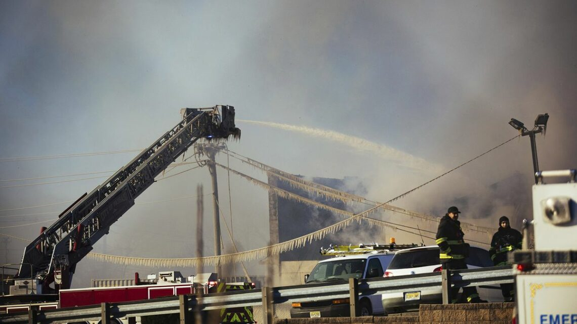 Crews Battle Flames, Cold, Wind in Huge Recycling Plant Fire