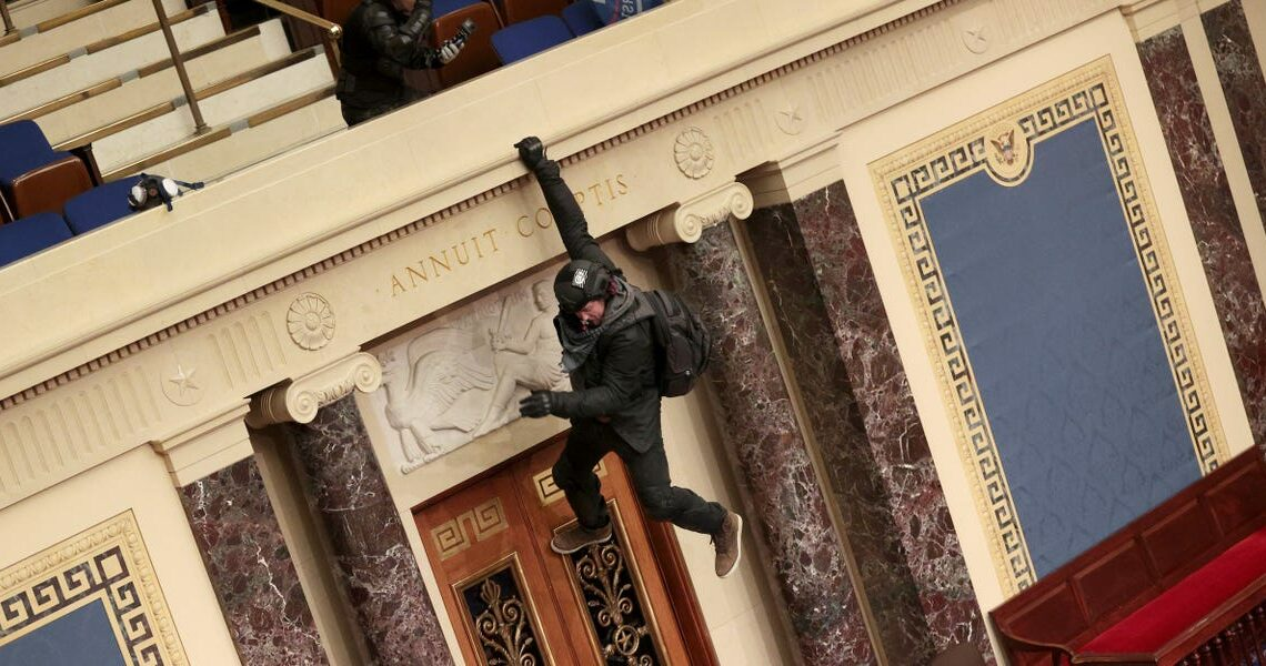 Photos show pro-Trump rioters inside the US Senate chamber