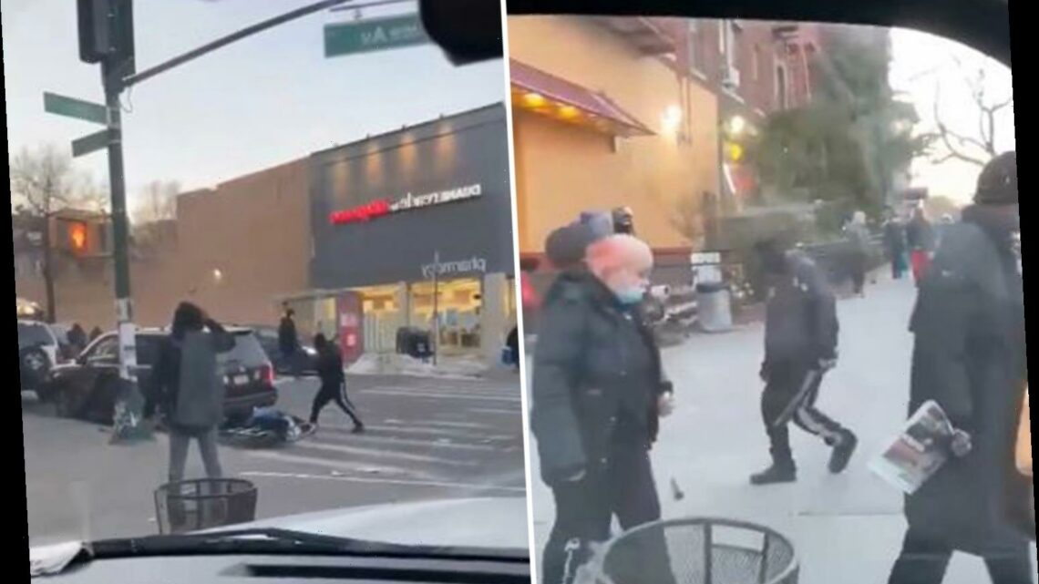 Shocking video shows baseball bat thug clubbing a cyclist unconscious in New York as people walk by without helping