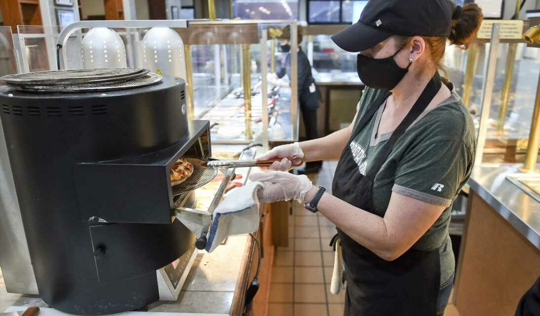 Job growth surges in February on hiring jump in restaurants and bars