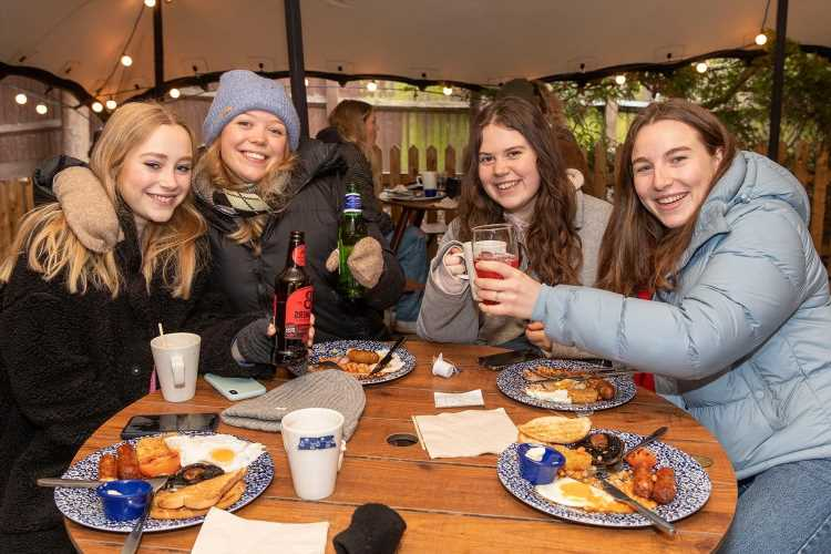 Dozens of drinkers brave bitter cold and flock to huge Wetherspoon beer garden for pints and fry ups