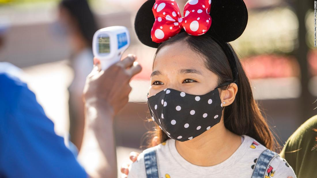 Disney CEO wants you back in the parks, mask and all
