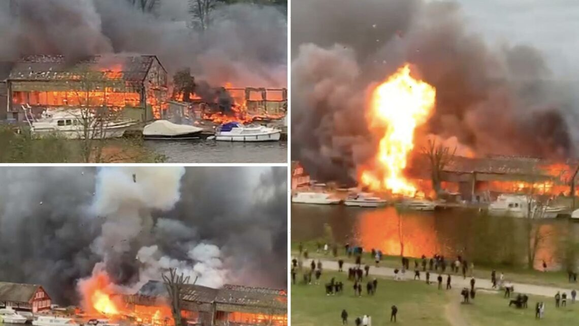 Explosions heard as 100 firefighters tackle huge blaze at historic boat house on Thames island near Hampton Court