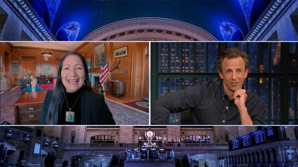 Seth Meyers catches Deb Haaland staffer crawling during on-cam interview
