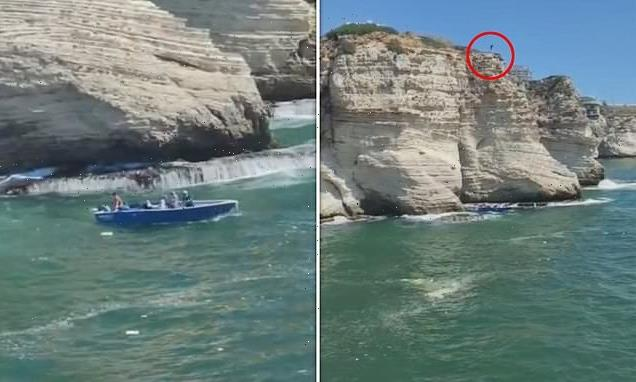 Man dies after jumping 120ft from cliff onto boat he didn't see