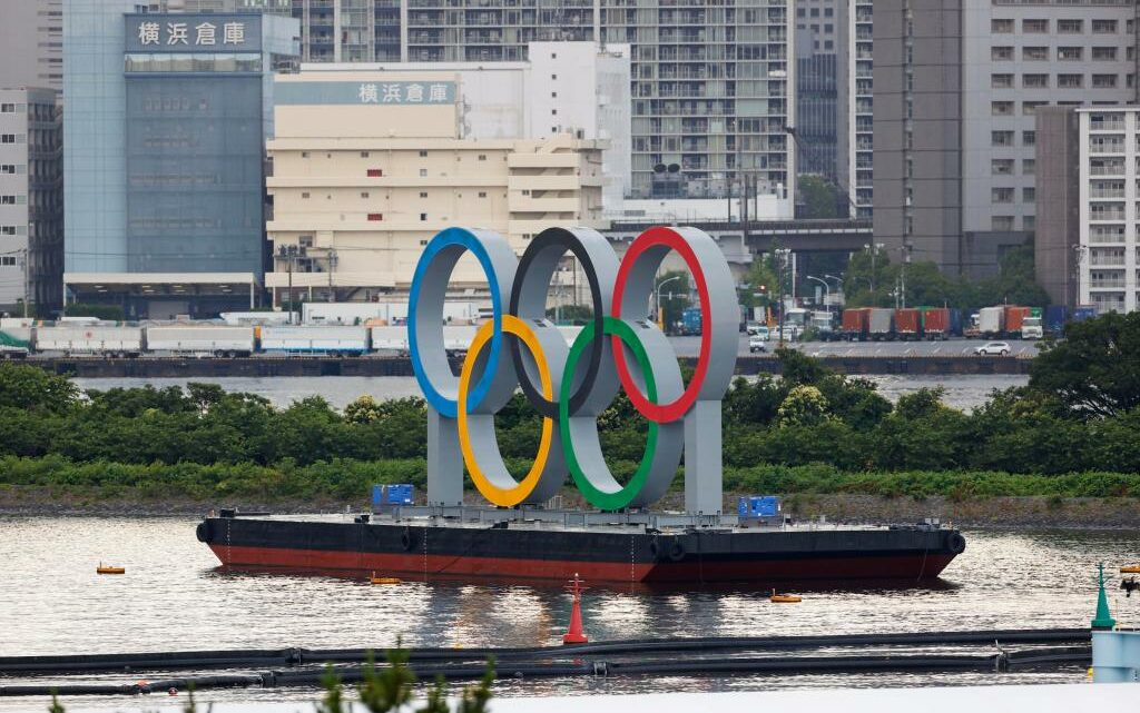NBCUniversal Puts On Its Game Face, Banging Olympics Promo Drums As Protests Continue In Tokyo