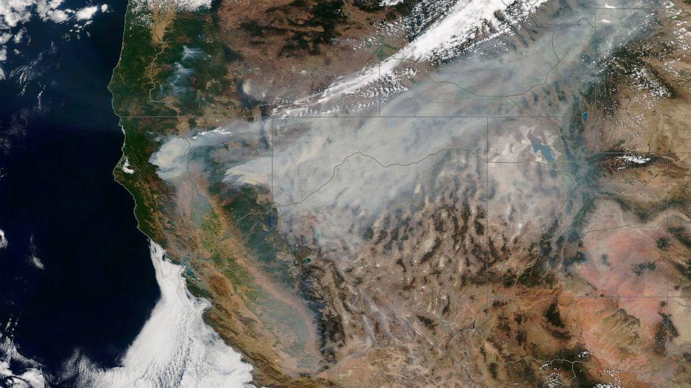 Huge California fire grows; Montana blaze threatens towns