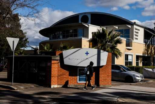 Sydney's hospitals under strain as coronavirus cases hit new daily record