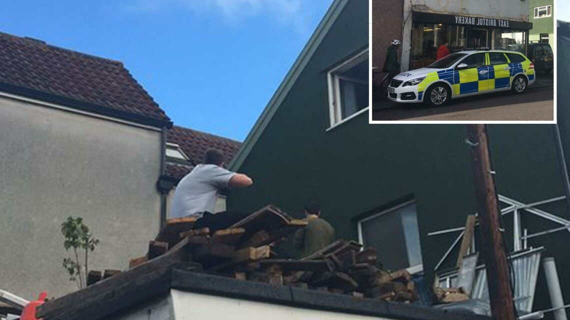 Dramatic moment residents protest on the ROOF in vicious tenancy spat with landlord as cops swoop