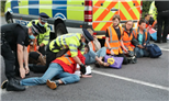 M25 protest: Heartbroken son reveals mum paralysed from stroke after eco-warriors saw him stuck in traffic for SIX HOURS