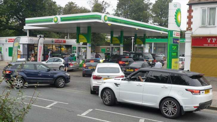 UK suspends competition law to tackle petrol panic buying as drivers rush to stations to fill up amid lorry shortages