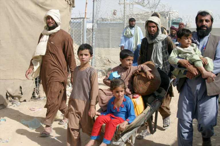 With airport closed, fearful Afghans scramble for the border