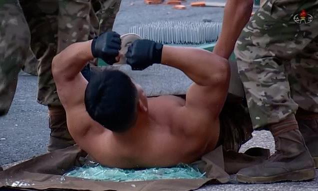 Kim Jong Un watches North Korean troops break bricks over their heads